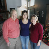 Record-Eagle/Keith King<br /> Luciana Rios, middle, a Rotary Youth Exchange student from Buenos Aires, Argentina, stands Thursday, December 27, 2012 with her host parents, Peter Schmitz, left, and Kim Schmitz, right, at their home in Traverse City.