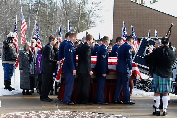 Record-Eagle/Jan-Michael Stump<br /> Pall bearers lead the casket of United States Air Force Tech Sgt. Matthew Schwartz from Christ the King Catholic Church in Acme Saturday following funeral services for the 34 year-old Traverse City native, who died in Afghanistan January 5, 2012.