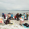 Record-Eagle/Keith King<br /> People dry off after taking a quick dip in West Grand Traverse Bay Tuesday, January 1, 2013 during the Crazy Times Ten New Year's Day jump in bay. Crazy Times Ten, the original group who organizes the event, is now entering its third year and jumps in West Grand Traverse Bay once a month. Those interested are welcome to participate with information being found at the 'Crazy Times Ten' Facebook page.