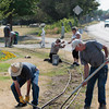 Record-Eagle/Jan-Michael Stump<br /> Volunteers from the Northwest Michigan Engine and Thresher Club remove the Spirit of Traverse City's train track from Clinch Park on Wednesday morning in preparation of the train's move to Buckley, where it will be on display during the Buckley Old Engine Show.