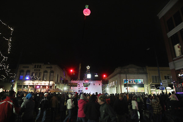 Record-Eagle/Keith King<br /> People gather at the intersection of Front Street and Cass Street for the 4th annual CherryT Ball Drop Monday, December 31, 2012 in Traverse City with food donations going toward the Goodwill food bank and monetary donations going toward Goodwill and the Traverse Bay Children's Advocacy Center.