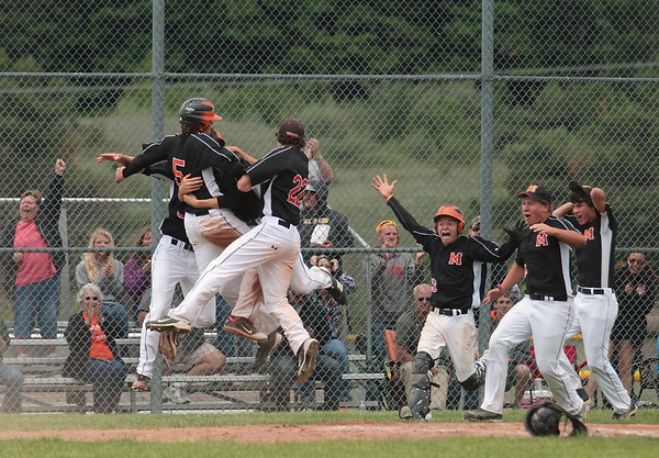 Record-Eagle/Keith King<br /> Mancelona celebrates after scoring the game-winning run against Newaygo to win the Division 3 quarterfinal Tuesday, June 12, 2012 at Traverse City West High School.