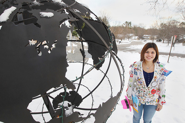 Record-Eagle/Keith King<br /> Luciana Rios, a Rotary Youth Exchange student from Buenos Aires, Argentina, wears her Rotary Youth Exchange blazer near a globe Thursday, December 27, 2012 at the home of her host family in Traverse City.