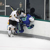 Record-Eagle/Jan-Michael Stump<br /> Traverse City Central's Austin Mackey (8) checks Saginaw Heritage's Mason Curnutt (20) Saturday at Centre ICE Arena.