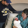 Record-Eagle/Keith King<br /> Jackson Cornell, of Traverse City, yawns as he is held by his mother Emily Cornell, as his father, Kevin Cornell, stands near Tuesday, January 1, 2013 at Munson Medical Center in Traverse City. Jackson, born early Tuesday morning, was the first baby born at Munson Medical Center in 2013.