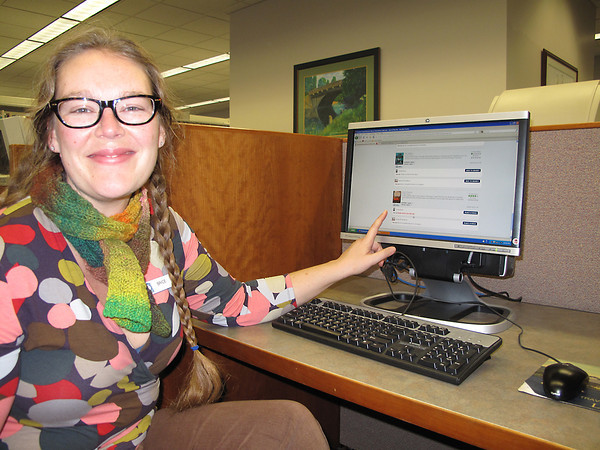 Reference librarian Brice Bush demonstrates how to check out an ebook—an increasingly popular option among  Traverse Area District Library patrons.