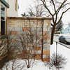 Record-Eagle/Keith King<br /> An automobile travels past the home of Kathie Scott, of Traverse City, Tuesday, January 1, 2013 on Division Street.