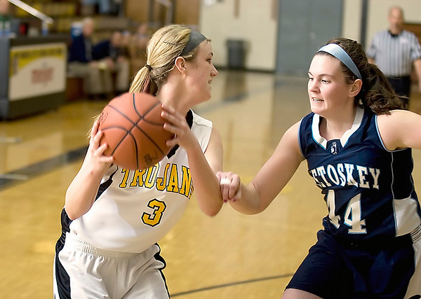 Record-Eagle/Keith King<br /> Petoskey's Kerby Tamm, right, defends Traverse City Central's Ali Walker at Traverse City Central.