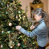 Record-Eagle/Keith King<br /> Barb Rishel, owner and innkeeper of the Antiquities' Wellington Inn, helps decorate rooms for Christmas.