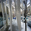Record-Eagle/Keith King<br /> Pedestrians are framed by icicles Wednesday in Traverse City.
