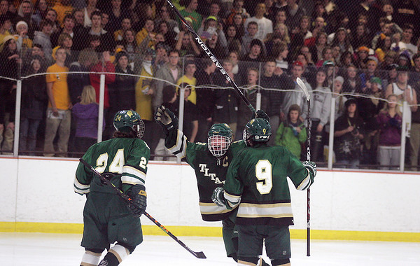 Record-Eagle/Keith King<br /> Traverse City West's Carson Omilusik celebrates after scoring a goal against Traverse City Central in Howe Arena at the Grand Traverse County Civic Center.