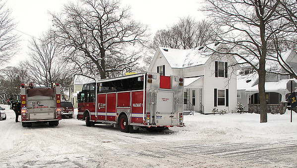 Record-Eagle/Alex Piazza<br /> Police and fire officials surround a home Thursday at the corner of Wadsworth and 10th streets in Traverse City. Authorities said they arrested a man who lived at the residence Wednesday night.