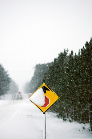 Record-Eagle/Keith King<br /> Snow covers a sign on Schell Road north of Buckley.