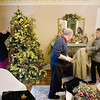 Record-Eagle/Keith King<br /> Yvette Rosales, left, and Don Sharpe, employees at the Antiquities' Wellington Inn, and Barb Rishel, right, Inn owner and innkeeper, decorate the Inn for Christmas.
