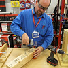 Record-Eagle/Mark Urban<br /> Thom Hooper of Sears demonstrates a hot tool for the holidays.