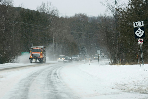 Record-Eagle/Keith King<br /> A snow plow travels along M-204.