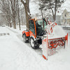 Record-Eagle/Keith King<br /> A sidewalk snowblower is operated Tuesday along Sixth Street in Traverse City.