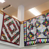 Record-Eagle/Keith King<br /> Quilts from the Pineneedlers Quilt Guild are exhibited Tuesday at Horizon Books in downtown Traverse City.