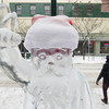Record-Eagle/Keith King<br /> An ice sculpture of Santa stands Tuesday near a crosswalk on Front Street in downtown Traverse City. Steven Berkshire, of Traverse City, created the eight downtown ice sculptures along Front Street and two logo ice sculptures at City Centre Plaza and Marc Pritchard created the Santa sculpture at City Centre Plaza. The ice sculptures were created for Santa's arrival and other events that took place during Downtown's Annual Holiday Open House last Friday in Traverse City.