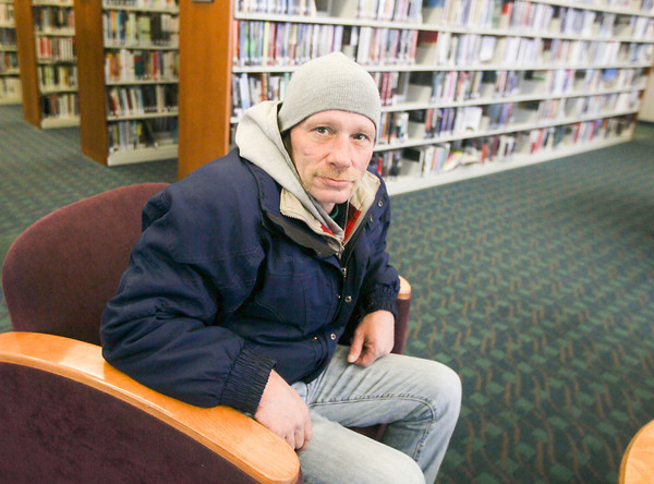 Record-Eagle/Keith King<br /> Allen Barkovich sits Monday at the Traverse Area District Library Woodmere Branch in Traverse City.