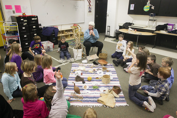 "Record-Eagle/Keith King<br /> Laura Quackenbush, of Lake Leelanau, conducts a ""Lifeways of the Woodland Indians"" presentation Thursday for a class of third-grade students at Glen Lake Community Schools."