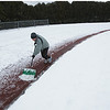 Record-Eagle/Keith King<br /> Roger Send, of Traverse City, shovels snow from the track Monday, December 10, 2012 at Traverse City Central High School in anticipation of using the track the next day for quarter-mile interval training which Send utilizes as a speed-training exercise. Send runs five times a week and does the quarter-mile interval training once a week.