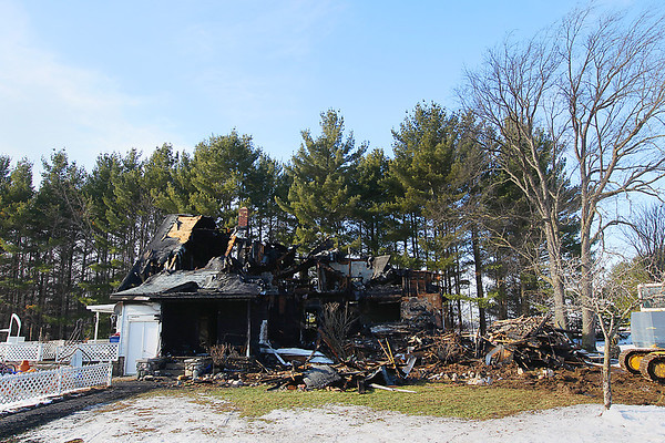 Record-Eagle/Keith King<br /> What remains of the house where George and Sally Shetler, owners of Shetler Family Dairy, lived, stands at Amazing Grace Farm in Kalkaska County's Excelsior Township Thursday, December 13, 2012 after a fire started there Wednesday.