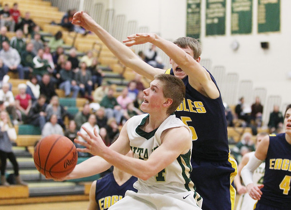 Record-Eagle/Keith King<br /> Traverse City West's Nate Castor (14) makes a move against Hudsonville's Cody Stuive (5) Monday, February 11, 2013 at Traverse City West High School.
