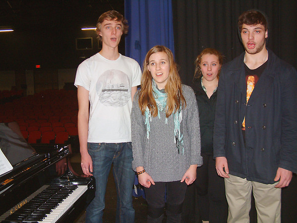 Record-Eagle/Marta Hepler Drahos<br /> From left, vocal quartet Alec Reznich, McKenna Cartwright, Abbey Kaufman and David Stone rehearse a love song for Traverse City Central High Choral-Aires' February 14 Singing Valentines.