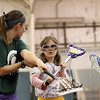 Record-Eagle/Jan-Michael Stump<br /> Michigan State University women's lacrosse player Sarah Whitney, left, work with Abigail Paul, 10, during a youth clinic Saturday at the Grand Traverse Bay YMCA.