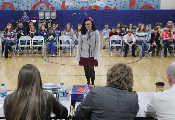 Record-Eagle/Keith King<br /> Grand Traverse Academy student Rebecca Petersen spells a word Monday, February 11, 2013 during the Grand Traverse County Spelling Bee at Grand Traverse Academy.