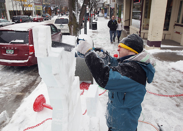 Record-Eagle/Keith King<br /> Sachel Ohlman-Vance, of Grand Rapids, and with Ice Sculptures Limited, creates an ice sculpture Friday, February 15, 2013 along Front Street during the Traverse City Winter Comedy Arts Festival.