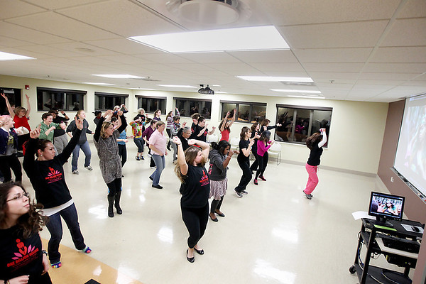Record-Eagle/Keith King<br /> Zumba instructor, Martha Hubbell, right, conducts a rehearsal Thursday, February 7, 2013 at Northwestern Michigan College for One Billion Rising, part of a worldwide dance to end violence against women and girls.