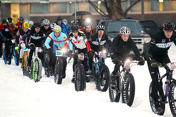 "Record-Eagle/Keith King<br /> Racers take off from the starting line Tuesday, February 13, 2013 during the Fat Tuesday Fat Bike Race, a race in the Northern Michigan Fat Bike Series, at the Grand Traverse County Civic Center. The next race in the series is scheduled for March 2 at the Marsh Ridge Golf Course and Resort in Gaylord. For more information visit  <a href=""http://www.nmfbs.com"">http://www.nmfbs.com</a>."