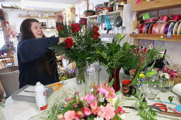 Record-Eagle/Keith King<br /> Nat Jorae, florist, prepares a vase of roses for Valentine's Day Wednesday, February 13, 2013 at Cottage Floral of Bellaire.