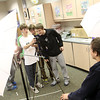 Record-Eagle/Jan-Michael Stump<br /> Glen Lake student Cooper Peterson, 13, left, takes a picture of Jared Peplinski , 13, far right and Carson Reay, 13, for the yearbook as Casey Peterson, 13, second from left, and Mike Skipski, 14, watch Thursday in class. The school district just received a grand from Best Buy to  combine technology and the arts.
