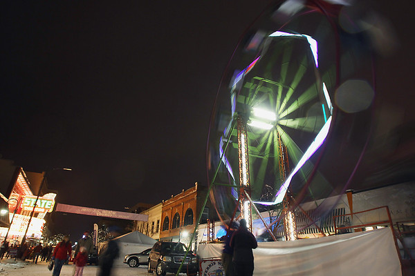 Record-Eagle/Keith King<br /> A ferris wheel spins on Front Street Friday, February 15, 2013 during the Traverse City Winter Comedy Arts Festival.