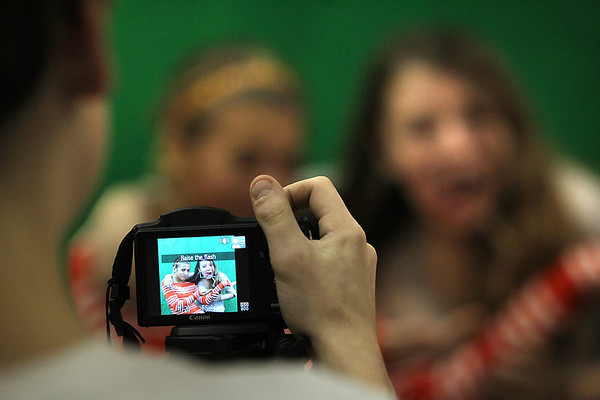 Record-Eagle/Jan-Michael Stump<br /> Glen Lake student Cooper Peterson, 13, takes a picture of Noelle Alonzi, 13, and Carson Reay, 13, for the yearbook Thursday in class. The school district just received a grand from Best Buy to  combine technology and the arts.