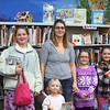 Record-Eagle/Loraine Anderson<br /> Susie Coon and her four home-schooled children come to the Kingsley Branch Library at least once a week to take out books.  From left, are Katy, 12; Megan, 2, Annie, 6, and Olivia 8.