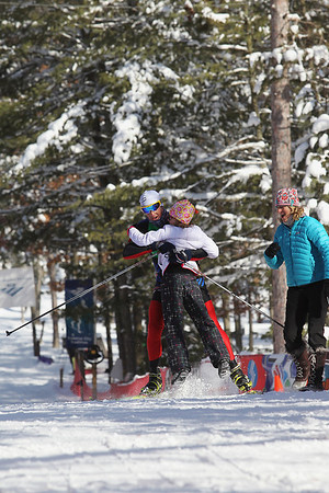 Record-Eagle/Jan-Michael Stump<br /> Men's 50k winner Eli Brown (23) carries his daughter Sage, 9, across the finish line in the North American VASA Saturday at Timber Ridge Resort in East Bay Township.