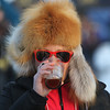 Record-Eagle/Jan-Michael Stump<br /> Anna Muehmel wears a fox and seal skin hat from Alaska while sampling an IPA at the 4th Annual Traverse City Winter Microbrew and Music FestivaL
