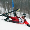 Record-Eagle/Jan-Michael Stump<br /> Rockford's Jake Lewis falls on his first giant slalom run in the division one ski regionals at Schuss Mountain in Bellaire.