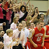 Record-Eagle/Jan-Michael Stump<br /> Suttons Bay players and fans celebrate during a run in the first half of Monday's win at Traverse City Central.