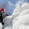 Record-Eagle/Keith King<br /> Graham Allingham, left, of Saginaw, and Clark Cederberg, of Frankenmuth, work on a snow sculpture for the Cherry Capital Winter Wowfest on Friday near the Traverse City Convention & Visitors Bureau.