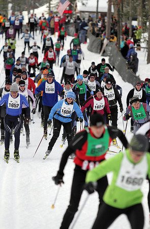 Record-Eagle/Keith King <br /> Skiers take off at the start of Saturday's North American Vasa at Timber Ridge Resort.