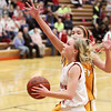 Record-Eagle/Keith King <br /> Benzie Central's Jordan Nye drives to the basket against Kingsley's Autumn Goggin Thursday, February 17, 2011 at Benzie Central High School.