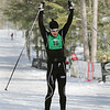 Record-Eagle/Keith King <br /> Jeff Koch raises his arms in triumph as he crosses the finish line in the Vasa 50K.