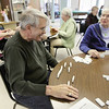 Record-Eagle/Keith King <br /> Jack Hardenburg, left, and Jeanne Curran, both of Traverse City, play dominoes Thursday, February 17, 2011 at the Traverse City Senior Center.