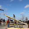 "Record-Eagle/Keith King<br /> Workers construct a ramp for the EpicHappens ""Downtown Throwdown Rail Jam"" in the parking lot at the intersection of Grandview Parkway and Union Street."