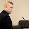 Record-Eagle/Jan-Michael Stump<br /> Michigan State Police Trooper Travis Peterson reads a statement before suspended Grand Traverse sheriff's Deputy Kipp Needham was sentenced in 86th District Court Wednesday after pleading guilty to one count of attempted assaulting, resisting or obstructing a police officer.